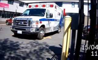 Ambulance leaves Planned Parenthood with lights flashing and sirens blaring